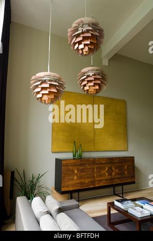 Living room with sofa and Louis Poulsen Artichoke lights - Stock-Bilder