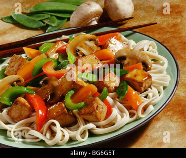 Stir fried tofu and vegetables with Asian noodles - Stock Image