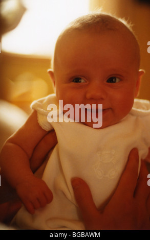 Photograph of baby babies holding smile happy cuddle future girl - Stock-Bilder