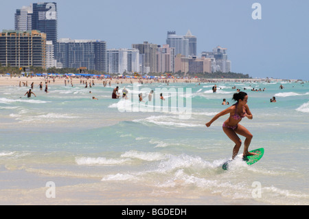 Surfer, skimboarder, Miami South Beach, Art Deco district, Florida, USA - Stock Image