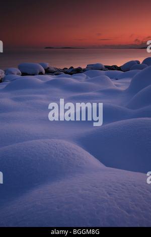 Snowy landscape and colorful skies at Larkollen in Rygge kommune, Østfold fylke, Norway. - Stock-Bilder