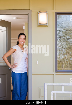 woman on front porch - Stock Image