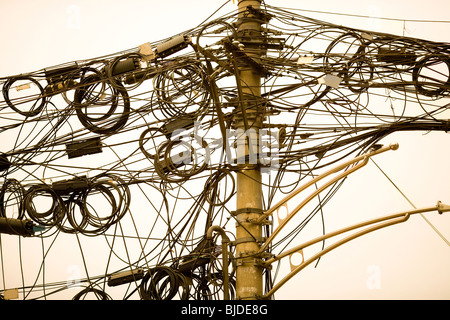 A tangle of cables and wires in Shanghai, China, Asia - Stock Image