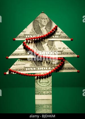 christmas tree made of money - Stock Image
