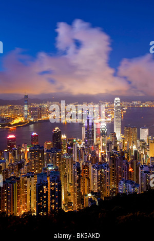 View over Hong Kong from Victoria Peak, the illuminated skyline of Central sits below The Peak, Victoria Peak, Hong - Stock Image