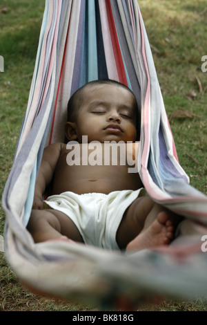 1 year old Asian baby sleeping on a hammock - Stock-Bilder