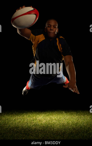 Rugby player about to score diving - Stock Image
