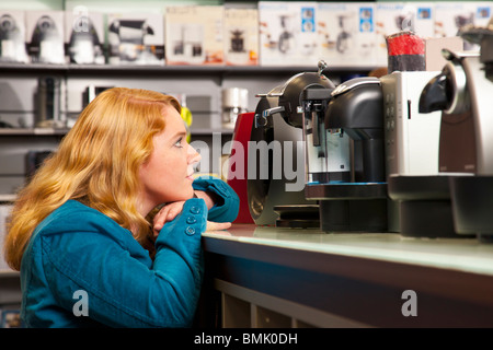 Girl is spoilt for choice - Stock Image