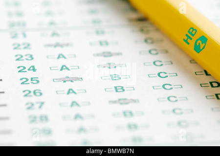 Optical scan answer sheet with #2 pencil representing education testing. - Stock Image