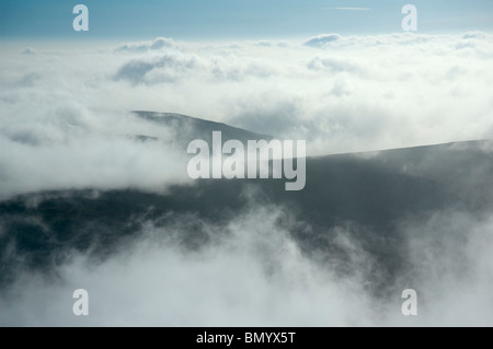 Mist and low cloud from the summit of Cadair Berwyn, Berwyn Hills, Snowdonia, North Wales, UK - Stock Image