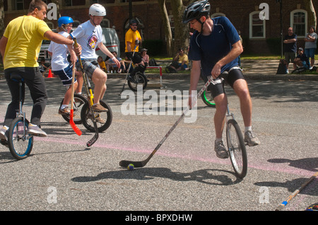 Unicyclists play  unicycle hockey at the New York City Unicycle Festival ( Unifest) - Stock Image
