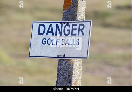 DANGER GOLF BALLS WARNING SIGN ON A BRITISH GOLF COURSE UK - Stock Image