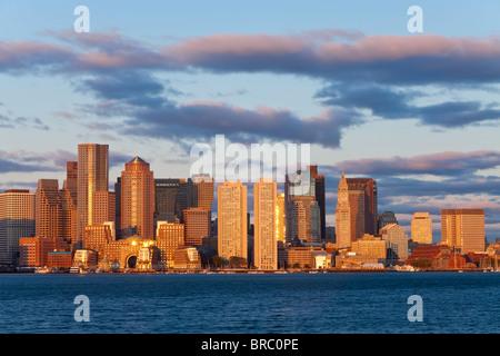 City skline viewed across Boston harbour at dawn, Boston, Massachusetts, New England, USA - Stock Image