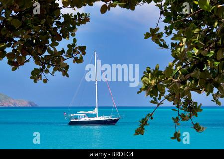 Sail boat moored at Megan's Bay. St. Thomas. US Virgin Islands - Stock Image