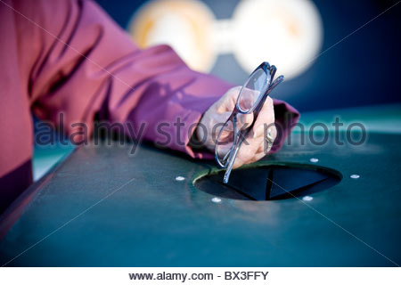 A senior woman recycling spectacles - Stock Image