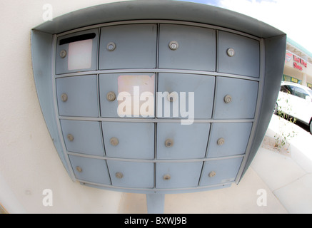free standing metal mail box, Post office box, next to an apartment building, USA - Stock Image