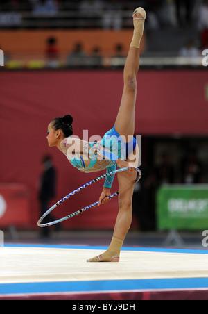 India Delhi 2010 XIX Commonwealth Games Rhythmic Gymnastics. Gymnast with hoop. - Stock Image
