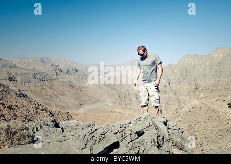 Young Male Adult in Military Attire in Arabian Mountains - Stock Image