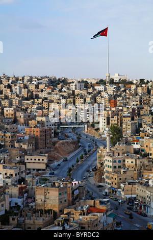 Large Jordanian flag flying over the city of Amman, Jordan - Stock Image
