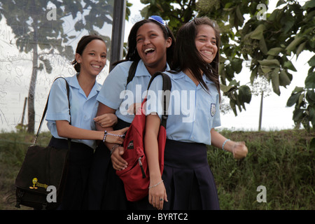Panama City Panama Tocumen sidewalk Hispanic Black girl student teen school uniform friends laughing - Stock Image