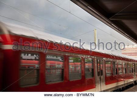 Train leaving station - Stock Image
