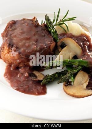 Lamb chop with asparagus mushrooms and mashed potato - Stock Image