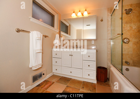 classic beige bathroom with white and wood cabinets tiles and beige walls tacoma - Bathroom Cabinets Tacoma