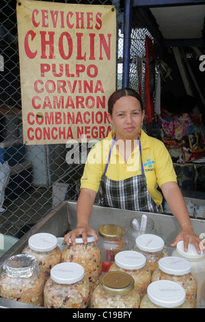 Panama City Panama Ancon Mercado de Mariscos market selling seafood vendor merchant Hispanic woman jars ceviche - Stock Image