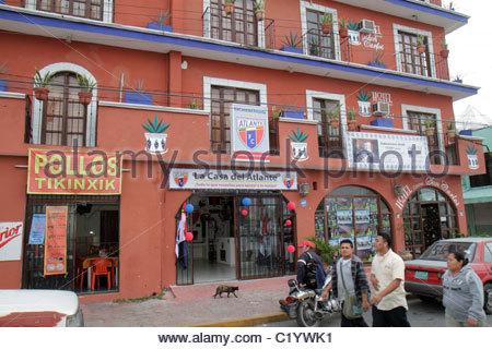 Cancun Mexico Yucatán Peninsula Quintana Roo Mercado 23 street scene small business storefront balcony Hotel - Stock Image