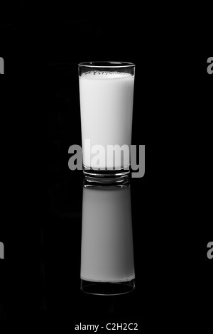 glass of milk on the black background - Stock Image