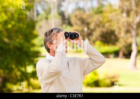 Mature man birds watching - Stock-Bilder