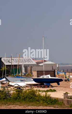 Beached boats on Whitstable beach, Kent - Stock Image