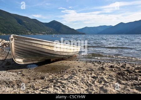 a rowing boat on Lake Maggiore, Ticino - Stock Image