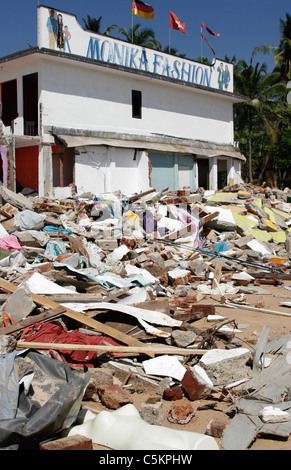 Sri Lanka, fashion shop on SW coast near Beruwela damaged by 2004 tsunami, mannequin amongst rubble of destroyed - Stock Image