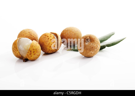 Longan fruits and leaves - Stock Image