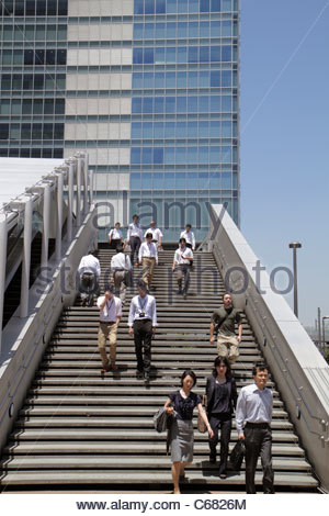 Japan Tokyo Akihabara office buildings steps stairs workers Asian man men woman women UDX Building - Stock Image