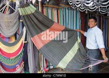 Managua Nicaragua Mercado Roberto Huembes market marketplace shopping store vendor business hammock braided rope - Stock Image