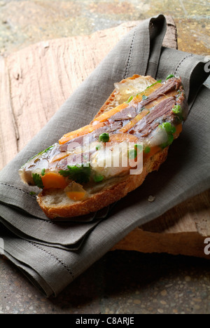 Beef in aspic on a slice of bread - Stock Image