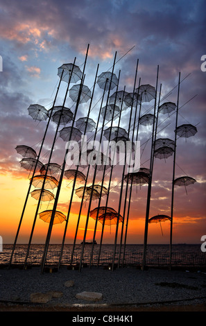 Greece, Thessaloniki.Sunset  at 'The Umbrellas' , an artistic installation, by George Zoggolopoulos. - Stock-Bilder