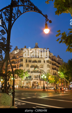 Casa Mila by Gaudi at twilight, laterne,Passeig de Gracia, - Stock Image