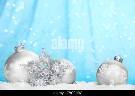Christmas balls with snowflake on abstract light background. - Stock Image