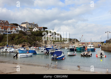 Newquay, Cornwall, England, UK, Britain. View from the beach to fishing boats moored in the harbour - Stock Image