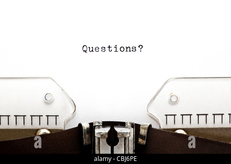 Questions? printed on an old typewriter - Stock Image
