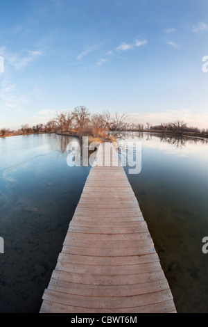 pathway, journey or goal concept - boardwalk and trail across lake and swamp, wide angle fisheye lens perspective - Stock-Bilder