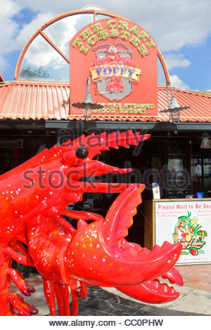 Louisiana New Orleans Spanish Plaza The Crazy Lobster restaurant business dining seafood fiberglass lobster statue - Stock Image