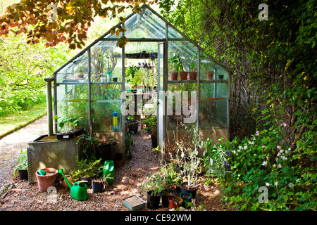 Personable Garden Water Butt Stock Photos  Garden Water Butt Stock Images  With Hot A Greenhouse In A Shady Corner Of An English Country Garden In Summer   Stock Image With Nice The Constant Gardener  Also Garden Design For Kids In Addition Wooden Garden Fence And Garden Metal Railings As Well As Garden Plants Sale Additionally Garden Jenga Argos From Alamycom With   Hot Garden Water Butt Stock Photos  Garden Water Butt Stock Images  With Nice A Greenhouse In A Shady Corner Of An English Country Garden In Summer   Stock Image And Personable The Constant Gardener  Also Garden Design For Kids In Addition Wooden Garden Fence From Alamycom