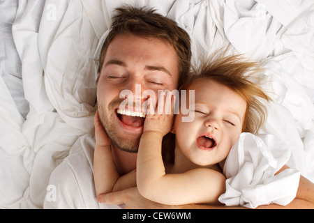 Father and daughter laughing and bonding - Stock Image
