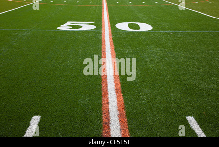 The 50 yard line of an American football field - Stock Image