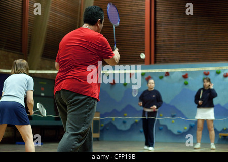 People playing a badminton game of doubles, Newmarket Suffolk UK - Stock Image