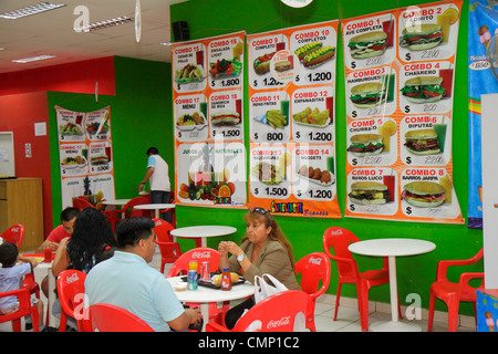 Chile Arica Hispanic cafe restaurant casual dining menu fast food hamburger price peso combo table resin chair Coca - Stock Image